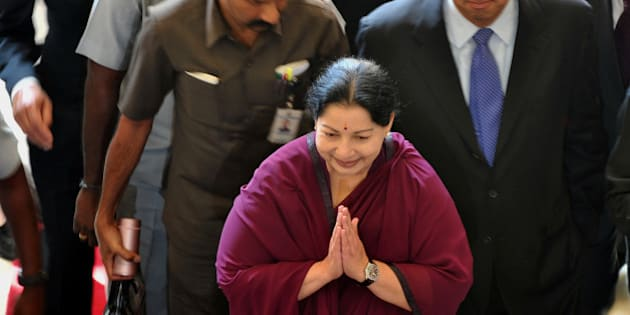 Indian chief minister of Tamil Nadu J. Jayalalithaa (C) arrives at a hotel in Bangalore to take part in  talks with chief Ministers of Tamil Nadu and Karnataka on the Cauvery water sharing row, on November 29, 2012. The talks failed to break the ice with both sides sticking to their positions. AFP PHOTO/ Manjunath KIRAN        (Photo credit should read Manjunath Kiran/AFP/Getty Images)