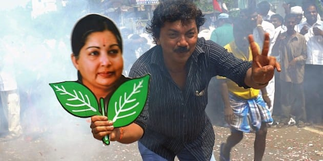 A supporter holds up a placard bearing the portrait of southern Indian state of Tamil Nadu Chief Minister and General Secretary of The All India Anna Dravida Munnetra Kazhagam (AIADMK) Party J. Jayalalithaa during celebrations in Chennai on May 16, 2014. India's triumphant Hindu nationalists declared 'a new era' in the world's biggest democracy Friday after hardline leader Narendra Modi propelled them to the biggest win in 30 years on promises to revitalise the economy.  AFP PHOTO/STR        (Photo credit should read STRDEL/AFP/Getty Images)