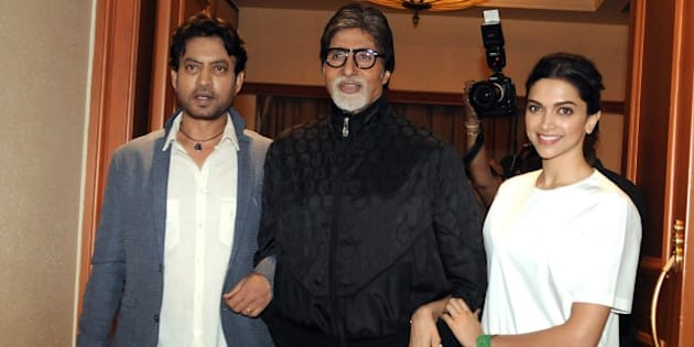 Indian Bollywood actors Irrfan Khan, (L), Amitabh Bachchan (C) and Deepika Padukone pose during the promotion of upcoming comedy-drama Hindi film 'Piku' directed by Shoojit Sircar in Mumbai on May 2, 2015.  AFP PHOTO        (Photo credit should read STR/AFP/Getty Images)