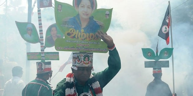 Indian supporters of Chief Minister of the southern Indian state of Tamil Nadu and the General Secretary of The All India Anna Dravida Munnetra Kazhagam (AIADMK) party, J.Jayalalithaa celebrate their party's victories in Tamil Nadu state, in Chennai on May 16, 2014.   India's triumphant Hindu nationalists declared 'a new era' in the world's biggest democracy Friday after hardline leader Narendra Modi propelled them to the biggest win in 30 years on promises to revitalise the economy.  AFP PHOTO        (Photo credit should read STR/AFP/Getty Images)