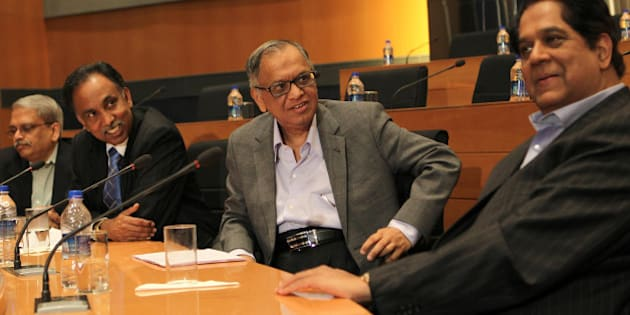 Indian founding member of Infosys, N.R. Narayana Murthy (2R), looks at outgoing chairman K.V. Kamath (R), as CEO SD Shibulal (2L) and former CEO Kris Gopalakrishna (L) look on at a press conference at the company's headquarter in Bangalore on June 1, 2013. Infosys on reappointed co-founder N.R. Narayana Murthy to lead the Indian outsourcing giant two years after he retired, as the company grapples with weak earnings and falling market share. AFP PHOTO/ Manjunath KIRAN        (Photo credit should read Manjunath Kiran/AFP/Getty Images)