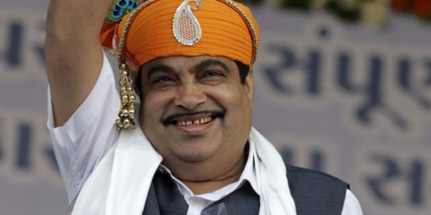 India's main opposition Bharatiya Janata Party (BJP) President Nitin Gadkari waves to the crowd during the conclusion of Gujarat state Chief Minister Narendra Modi's month-long Vivekananda Yuva Vikas Yatra or Vivekananda Youth Development Tour at Pavagadh, about 160 kilometers (100 miles) east of Ahmadabad, India, Thursday, Oct. 11, 2012. The Gujarat state elections are scheduled to be held in December. (AP Photo/Ajit Solanki)