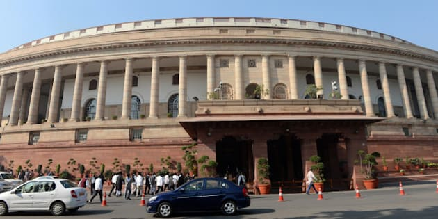 Visitors walk outside at the opening of the Winter session of Parliament in New Delhi on December 5, 2013.  Parliament adjourned for the day after both houses condoled the death of two sitting members, 27 people in a building collapse in Mazgaon area of Mumbai in September, those who lost their lives in Phailin and Helen cyclones in India and the deaths in super typhoon Haiyan in the Philippines. AFP PHOTO/RAVEENDRAN        (Photo credit should read RAVEENDRAN/AFP/Getty Images)