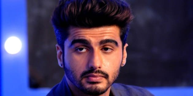 Indian Bollywood actor Arjun Kapoor poses for a photograph during a promotional event in Mumbai on late July 7, 2014. AFP PHOTO / STR        (Photo credit should read STRDEL/AFP/Getty Images)