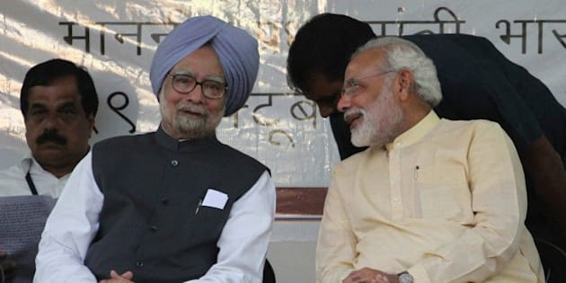 Indian Prime Minister Manmohan Singh, second left, and Gujarat state chief Minister Narendra Modi, right, interact during the inauguration of the renovated memorial of Sardar Vallabhbhai Patel, one of the founding fathers of the Indian republic, in Ahmadabad, India, Tuesday, Oct. 29, 2013. Modi is the opposition Bharatiya Janata Party's (BJP) prime ministerial candidate for the 2014 general elections. (AP Photo/Ajit Solanki)