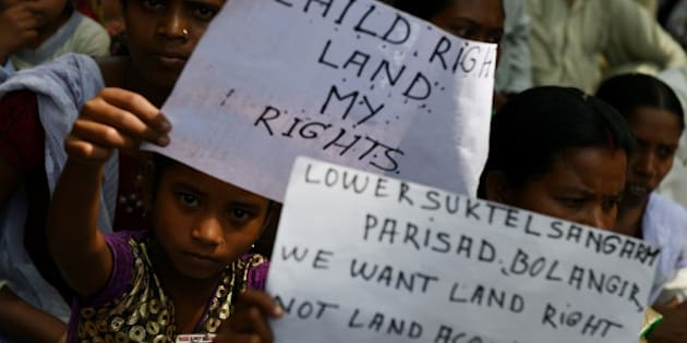 Indian protestors are joined by children holding placards during a rally in New Delhi on May 5, 2015, against the ruling governments proposed land acquisition bill.   Anger has also been mounting in rural Indian areas over  Prime Minister Narendra Modi's land reform bill, which the government says is needed speed up economic growth, but political opponents say favours big business at the expense of struggling farmers.   AFP PHOTO/MONEY SHARMA.        (Photo credit should read MONEY SHARMA/AFP/Getty Images)