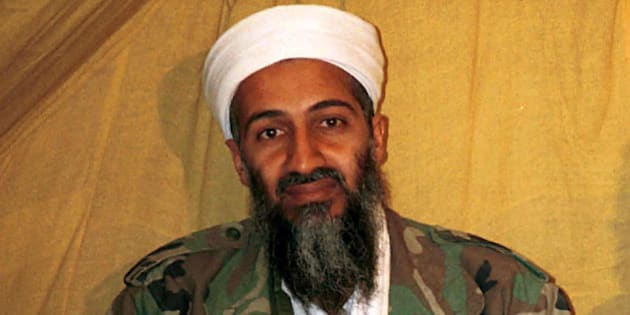"""FILE - This undated file photo shows al Qaida leader Osama bin Laden in Afghanistan. A new book due out Tuesday, Oct. 16, 2012 says President Barack Obama hoped to put Bin Laden on trial if he had surrendered during a U.S. raid. Author Mark Bowden quotes the president as saying he thought he could make a strong political argument for giving bin Laden the full rights of a criminal defendant, to show U.S. justice applies even to him. In """"The Finish,"""" Bowden writes, however, that Obama said he expected the terror leader to go down fighting. (AP Photo)"""