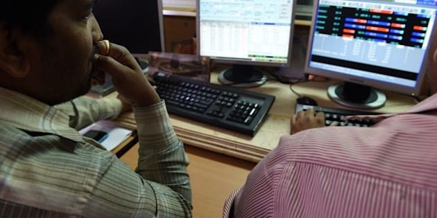 A stock dealer watches share prices on his screen at a brokerage house in Mumbai on January 6, 2015. The BSE 30 share benchmark index - SENSEX  plunged over 600 points in trade in cue with the sink in Asian markets, which were trading lower as investors are starting to worry that the prolonged slump is signaling a weaker global economy.   AFP PHOTO / INDRANIL MUKHERJEE        (Photo credit should read INDRANIL MUKHERJEE/AFP/Getty Images)