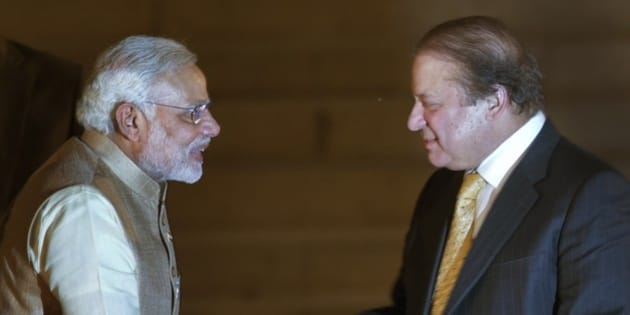 India's new prime minister Narendra Modi, left, shakes hands with his Pakistani counterpart Nawaz Sharif,  during Modi's inauguration in New Delhi, India, Monday, May 26, 2014. Modi took the oath of office as India's new prime minister at the sprawling presidential palace on Monday, a moment made more historic by the presence of the leader of archrival Pakistan. (AP Photo /Manish Swarup)