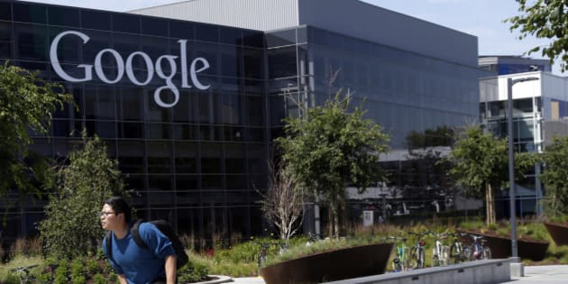 FILE - In this June 5, 2014 file photo, a worker rides a bike on Google's campus in Mountain View, Calif. Google, Yahoo and other major technology companies are far more inclined to hire Asians as computer programmers than to promote them to become managers or executives, according to a study released Wednesday, May 6, 2015. (AP Photo/Marcio Jose Sanchez, File)