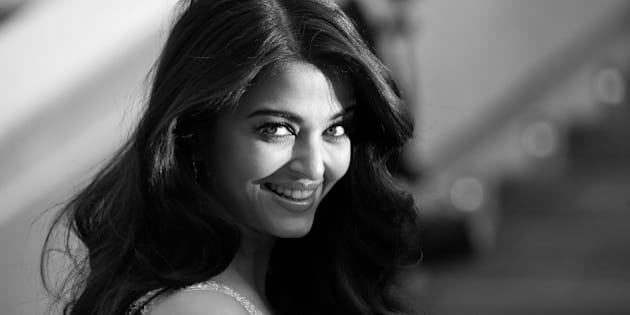 BLACK AND WHITE VERSION Indian actress Aishwarya Rai Bachchan poses as she arrives for the screening of the film 'The Search' at the 67th edition of the Cannes Film Festival in Cannes, southern France, on May 21, 2014.        AFP PHOTO / ALBERTO PIZZOLI        (Photo credit should read ALBERTO PIZZOLI/AFP/Getty Images)