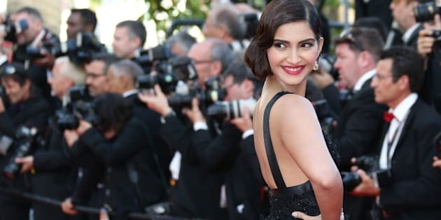 Indian actress Sonam Kapoor poses as she arrives for the screening of the film 'The Homesman' at the 67th edition of the Cannes Film Festival in Cannes, southern France, on May 18, 2014.     AFP PHOTO / LOIC VENANCE        (Photo credit should read LOIC VENANCE/AFP/Getty Images)