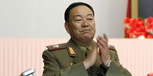Vice Marshal Hyon Yong Chol applauds during a meeting at the April 25 House of Culture announcing North Korean leader Kim Jong Un's new title of marshal, Wednesday, July 18, 2012, in Pyongyang, North Korea.  The decision to award the top title to Kim, who already serves as supreme commander of the Korean People's Army, was made Tuesday by the nation's military, government and political leadership, state media said in a special bulletin. The move solidifying his standing comes seven months into Kim's rule.  (AP Photo/Jon Chol Jin)
