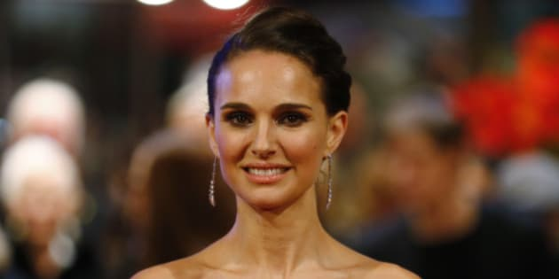 Actress Natalie Portman poses for photographers on the red carpet of the film Knight of Cups at the 2015 Berlinale Film Festival in Berlin Sunday, Feb. 8, 2015. (AP Photo/Axel Schmidt)