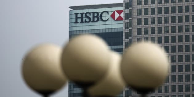 """Street lamps stand in the foreground as an exterior views shows a logo on the global headquarters building of HSBC in the Canary Wharf business district of London, Friday, April 24, 2015.  HSBC is considering moving its headquarters from Britain in the wake of """"regulatory and structural reforms"""" imposed after the 2008 financial crisis, the bank's chairman said Friday. (AP Photo/Matt Dunham)"""