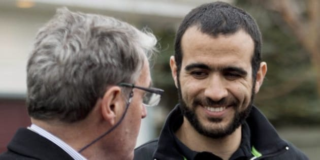 Omar Khadr, right, smiles at his lawyer Dennis Edney, left, as they speak to the media outside his new home after being granted bail in Edmonton on Thursday, May 7, 2015. THE CANADIAN PRESS/Nathan Denette