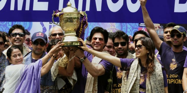 Kolkata Knight Riders team co-owners and Bollywood actors Shah Rukh Khan, center and Juhi Chawla, second right, pose with West Bengal state Chief Minister Mamata Banerjee, left, and captain Gautam Gambhir, second left in cap, during a reception accorded to the team at the Eden Gardens stadium in Kolkata, India, Tuesday, May 29, 2012. Kolkata Knight Riders won the Indian Premier League cricket title on Sunday, defeating two-time defending champion Chennai Super Kings by five wickets in a high-scoring final. (AP Photo)