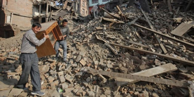 Nepalese people recover their belongings from earthquake destroyed buildings in Bhaktapur, Nepal, Thursday, May 14, 2015. The past three weeks have been misery for Nepal. On April 25, a magnitude-7.8 earthquake killed thousands of people, injured tens of thousands more and left hundreds of thousands homeless. Then, just as the country was beginning to rebuild, a magnitude-7.3 earthquake battered it again. (AP Photo/Bikram Rai)