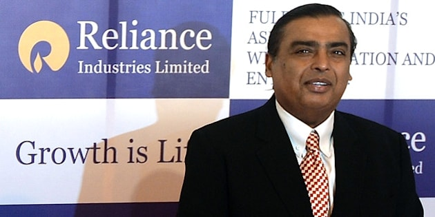 Reliance Industries Chairman Mukesh Ambani poses as he arrives for the company's  annual general meeting in Mumbai on June 6, 2013. India's largest private firm Reliance Industries plans to invest 1.5 trillion rupees (USD26 billion) in all its businesses over the next three years,  its chairman Mukesh Ambani told shareholders.  Reliance is India's largest private oil and gas explorer with a strong presence in the petrochemicals and polyester sectors and has expanded into the fast-growing broadband and retail segments in recent years.   AFP PHOTO/Indranil MUKHERJEE        (Photo credit should read INDRANIL MUKHERJEE/AFP/Getty Images)