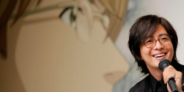 South Korean actor Bae Yong-joon smiles during a news conference to promote the animation version of his popular TV drama  'Winter Sonata'  in Tokyo, Japan, Tuesday, Sept. 29, 2009. (AP Photo/Itsuo Inouye)