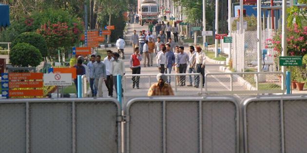 Indian employees of the Ranbaxy Laboratories Limited pharmaceutical Indian factory leave work at the end of the day at Toansa village in Ropar about 50 Km from Chandigarh on May 14, 2013.  The US subsidiary of New Delhi-based Ranbaxy Laboratories pleaded guilty to seven counts of felony after it distributed several India-produced adulterated generic drugs in the United States in 2005 and 2006. They were all made in a facility near Chandigarh city in northern India, which US Food and Drug Administration inspectors cited for poor record keeping and inadequate testing for the stability of the drugs over time. AFP PHOTO/ NARINDER NANU        (Photo credit should read NARINDER NANU/AFP/Getty Images)