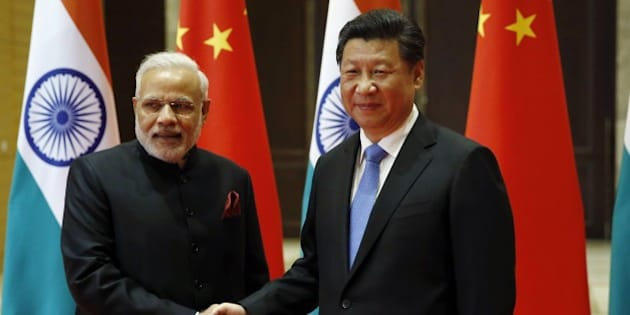 India's Prime Minister Narendra Modi (L) and China's President Xi Jinping shake hands before they hold a meeting in Xian, in China's Shaanxi province, on May 14, 2015.  Modi began a three-day trip to China on May 14 by inspecting the Terracotta Warriors as a festering border dispute colours relations between the Asian giants.       AFP PHOTO / POOL / Kim Kyung-Hoon        (Photo credit should read KIM KYUNG-HOON/AFP/Getty Images)