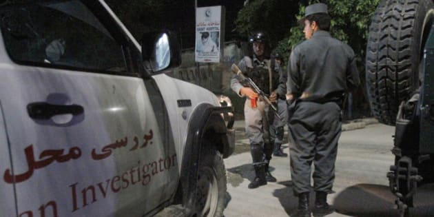 Afghan security forces inspect the site of the Park Palace Hotel attacked by gunmen, in Kabul, Afghanistan, Thursday, May 14, 2015. Gunmen stormed the guesthouse on Wednesday night as it hosted a party for foreigners. An hourslong siege ended early Thursday morning. (AP Photo/Allauddin Khan)