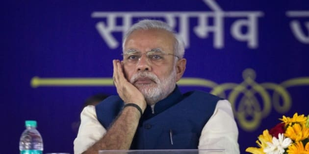 Indian Prime Minister Narendra Modi listens to a speaker after unveiling the foundation stone for an international center dedicated to Ambedkar, in New Delhi, India, Monday, April 20, 2015. Ambedkar, an untouchable, or Dalit, and a prominent Indian freedom fighter, was the chief architect of the Indian Constitution, which outlawed discrimination based on caste.(AP Photo/Saurabh Das)