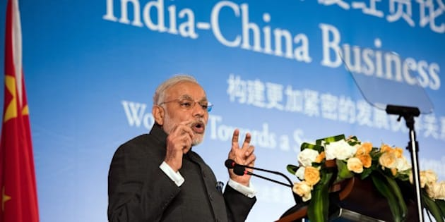 India's Prime Minister Narendra Modi delivers a speech at the India-China Business Forum in Shanghai on May 16, 2015.  Indian and Chinese firms signed 21 agreements officials said were worth a total of more than 22 billion USD witnessed by visiting Prime Minister Narendra Modi.     AFP PHOTO / JOHANNES EISELE        (Photo credit should read JOHANNES EISELE/AFP/Getty Images)