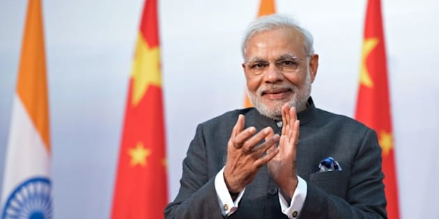 India's Prime Minister Narendra Modi applauds as he attends the opening ceremony for the Centre for Gandhian and Indian Studies at Fudan University in Shanghai on May 16, 2015. Modi is on a three-day visit to China. AFP PHOTO / JOHANNES EISELE        (Photo credit should read JOHANNES EISELE/AFP/Getty Images)