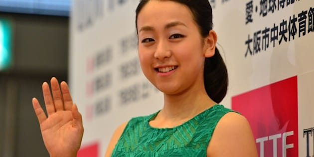 Japan's figure skating world champion Mao Asada waves after a press conference for the upcoming ice show 'The Ice' in Tokyo on May 19, 2014. Asada will sit out competitive figure skating next season but will take part in potentially lucrative commercial ice shows in the coming months. Asada won her third women's world figure skating title in March before a roaring home crowd, springing back from a disappointing result at the Sochi Olympics in February.   AFP PHOTO / Yoshikazu TSUNO        (Photo credit should read YOSHIKAZU TSUNO/AFP/Getty Images)