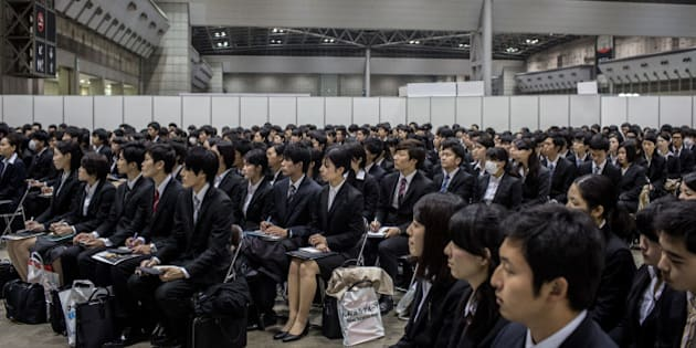 TOKYO, JAPAN - MARCH 08:  (EDITORIAL USE ONLY) College students listen to a company information session at the Mynavi Shushoku MEGA EXPO at the Tokyo Big Sight on March 8, 2015 in Tokyo, Japan. 70,000 job-seeking students are expected to attend the two-day career fair with 1230 companies participating. Under new rules starting this academic year, companies are allowed to conduct recruiting activities from March 1 onward, rather than December so that third-year university students can concentrate on their studies.  (Photo by Chris McGrath/Getty Images)
