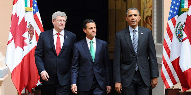 US President Barack Obama (R), Mexican President Enrique Pena Nieto (C) and Canadian Prime Minister Stephen Harper arrive to participate in a trilateral North American Leaders summit meeting at the Palacio de Justicia in Toluca, Mexico, on February 19, 2014. The three leaders joined for the summit of North American Leaders for talks focusing on 'a range of issues important to the daily lives of all of North America's people, including economic competitiveness, entrepreneurship, trade and investment, and citizen security.' AFP PHOTO/Jewel Samad        (Photo credit should read JEWEL SAMAD/AFP/Getty Images)