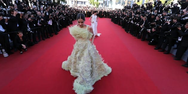 Indian actress Sonam Kapoor poses as she arrives for the screening of the film 'Inside Out' at the 68th Cannes Film Festival in Cannes, southeastern France, on May 18, 2015.      AFP PHOTO / VALERY HACHE        (Photo credit should read VALERY HACHE/AFP/Getty Images)