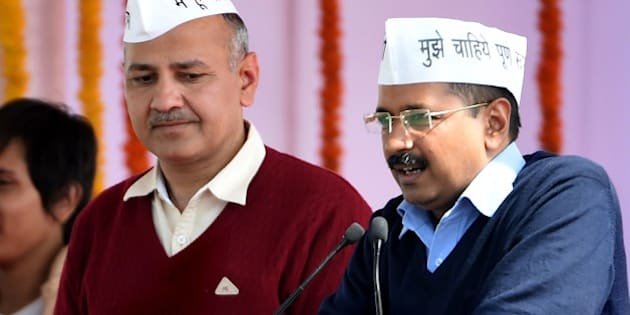 Aam Aadmi Party (AAP) president Arvind Kejriwal (R), with fellow AAP minister Manish Sisodia, addresses supporters during Kejriwal's swearing-in ceremony as Delhi chief minister in New Delhi on February 14, 2015.  Arvind Kejriwal promised to make Delhi India's first corruption-free state and end what he called its 'VIP culture' as he was sworn in as chief minister before a huge crowd of cheering supporters .   AFP PHOTO / PRAKASH SINGH        (Photo credit should read PRAKASH SINGH/AFP/Getty Images)