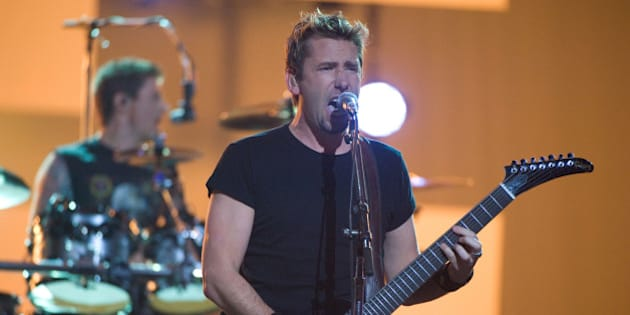 Singer Chad Kroeger and drummer Daniel Adair of Nickelback perform at the Juno Awards on Sunday, April 1, 2012, in Ottawa, Ontario. (AP Photo/Arthur Mola)