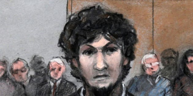 In this courtroom sketch, Boston Marathon bomber Dzhokhar Tsarnaev stands as a death by lethal injection sentence is read at the Moakley Federal court house in the penalty phase of his trial in Boston, Friday, May 15, 2015. The federal jury ruled that the 21-year-old Tsarnaev should be sentenced to death for his role in the deadly 2013 attack. (Jane Flavell Collins via AP)