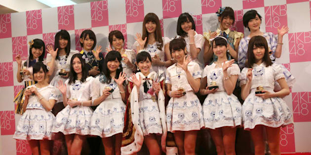 The top 15 members of Japan's all-girl pop idol group AKB48, from top left in clockwise, Aya Shibata, Yui Yokoyama, Sakura Miyawaki, Minami Takahashi, Haruna Kojima, Akari Suda, Sae Miyazawa, Rina Ikoma, Haruka Shimazaki, Rena Matsui, Yuki Kashiwagi, Mayu Watanabe, Rina Sashihara, Jurina Matsui and Sayaka Yamamoto pose for photographers after the annual AKB48 popularity poll in Tokyo, Saturday, June 7, 2014.  In the event, fans pick their favorites from the group members. (AP Photo/Eugene Hoshiko)