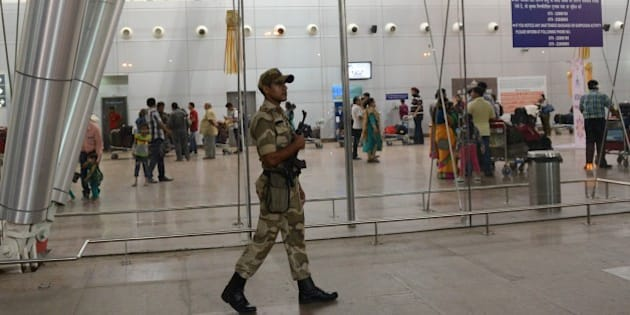 An Indian paramilitary soldier from the Central Industrial Security Force (CISF) keeps vigil at the Sardar Vallabhbhai Patel International airport in Ahmedabad on October 24, 2014, after major airports across India have been put on alert following the warning of an attack. Intelligence reports said suicide bombers could imminently attempt to board Air India flights from Mumbai and Ahmedabad airports.  AFP PHOTO / Sam PANTHAKY        (Photo credit should read SAM PANTHAKY/AFP/Getty Images)