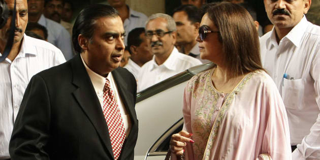 India's corporate giant Reliance Industries Ltd. Chairman Mukesh Ambani, left, and his wife Nita arrive for the company's annual general meeting in Mumbai, India, Friday, June 3, 2011. Ambani announced that the company would become debt-free in the current financial year. (AP Photo/Rajanish Kakade)