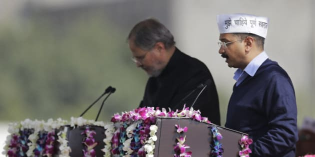 Aam Aadmi Party, or Common Man's Party, leader Arvind Kejriwal takes the oath of office as Delhi's new Chief Minister, in New Delhi, India, Saturday, Feb. 14, 2015. The AAP, headed by the former tax official who had remade himself into a champion for clean government, won 67 of the 70 seats in recent elections. Kejriwal and the party he created routed the country's best-funded and best-organized political machine and dealt an embarrassing blow to Prime Minister Narendra Modi. (AP Photo/Altaf Qadri)