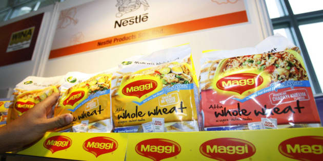 "In this photo taken on April 21, 2010, a man picks up a package of Maggi instant noodle made of whole wheat manufactured by Nestle Malaysia at the 7th World Instant Noodle Summit in Kuala Lumpur, Malaysia. More than a half-century after his father invented instant noodles to feed Japan's war-ravaged masses, Koki Ando says it is time to change the high-calorie, salt-laden fast food into healthier fare for the fastidious. In Malaysia, leading manufacturer Maggi is promoting ""Tastylite"" soup noodles made of whole wheat, with every packet providing the same amount of fiber as nearly one-and-a-half slices of whole wheat bread. (AP Photo/Lai Seng Sin)"