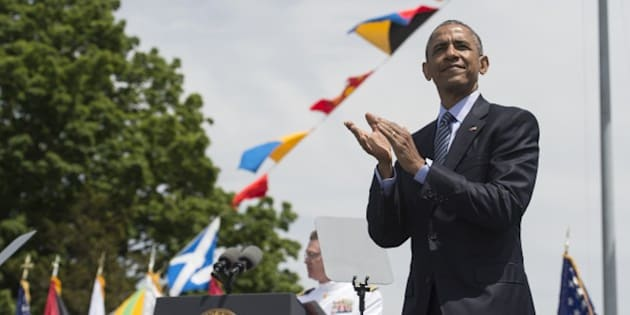 US President Barack Obama applauds at the end of the 134th Commencement Exercises of the United States Coast Guard Academy in New London, Connecticut, on May 20, 2015.    AFP PHOTO/NICHOLAS KAMM        (Photo credit should read NICHOLAS KAMM/AFP/Getty Images)
