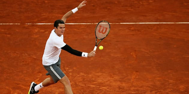 MADRID, SPAIN - MAY 08:  Milos Raonic of Canada volleys against Andy Murray of Great Britain in their quarter final match during day seven of the Mutua Madrid Open tennis tournament at the Caja Magica  on May 8, 2015 in Madrid, Spain.  (Photo by Clive Brunskill/Getty Images)