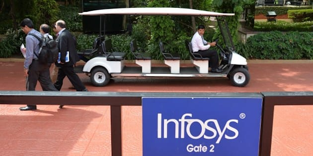 Employees of Infosys walk inside the lush green premises as the company announces its first quarter results at their Bangalore facility on July 11, 2014.   Indian outsourcing giant Infosys reported on July 11 a better-than-expected 21 percent jump in quarterly net profit, after winning new deals from US clients.    AFP/Manjunath KIRAN        (Photo credit should read Manjunath Kiran/AFP/Getty Images)