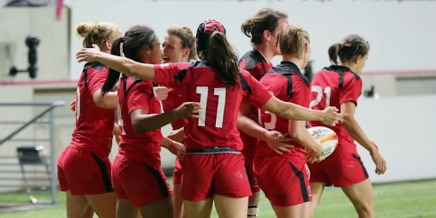 Canadian players celebrate after Magali Harvey, second from left, scored the second try for her team, during the semi final match of the Women's Rugby World Cup 2014 between France and Canada, at Jean Bouin stadium, in Paris, Wednesday, Aug. 13, 2014. Canada won 18-16 and will play against England in the final on Sunday. (AP Photo/Remy de la Mauviniere)