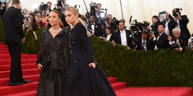 Mary-Kate and Ashley Olsen arrive at the Costume Institute Benefit at The Metropolitan Museum of Art May 5, 2014 in New York. AFP PHOTO/Timothy A. CLARY        (Photo credit should read TIMOTHY A. CLARY/AFP/Getty Images)
