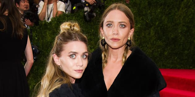 """Mary Kate Olsen, left, and Ashley Olsen arrive at The Metropolitan Museum of Art's Costume Institute benefit gala celebrating """"China: Through the Looking Glass"""" on Monday, May 4, 2015, in New York. (Photo by Charles Sykes/Invision/AP)"""