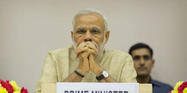 Indian Prime Minister Narendra Modi attends a function to mark the national Panchayati Raj or village civil council day, in New Delhi, India, Friday, April 24, 2015. Modi on Friday urged Panchayat members to work with a five-year vision with concrete development plans to bring about positive changes in their village and also emphasized on the need for education, according to local reports. (AP Photo/Manish Swarup)