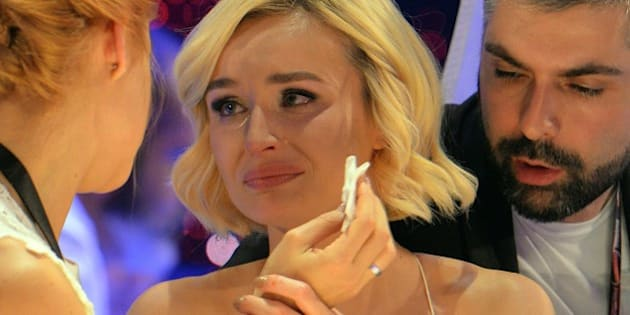 Polina Gagarina representing Russia, centre, reacts as the results start to come in during the final of the Eurovision Song Contest in Austria's capital Vienna, Saturday, May 23, 2015. (AP Photo/Kerstin Joensson)